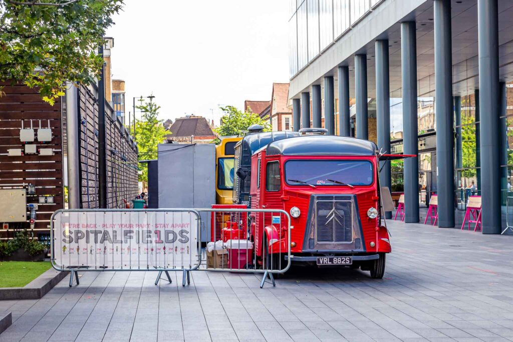 Entrance and red food truck in Spitalfields Market London